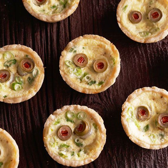 Creepy red eyes (olives) make these zombie quiches the perfect party appetizer: http://www.bhg.com/halloween/recipes/halloween-recipe-ideas/?socsrc=bhgpin082114eyeballquiche&page=2