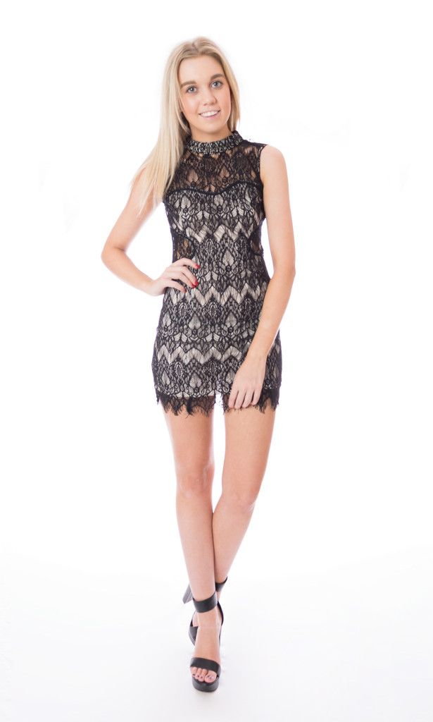 Black lace dress with gold lining Click to buy now