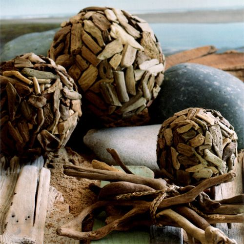 Driftwood Balls and Natural Driftwood Stick Bundle. Create a natural beach ambiance with our melange of Driftwood Balls. Intricately formed balls feature variegated chips of sand-smoothed driftwood. Our loose bundle of natural driftwood sticks is tied with natural rope for a ready made seaside display. From the Driftwood Collection at SeasideInspired.com