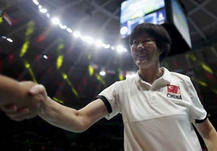 016 Rio Olympics - Volleyball - Women's Gold Medal Match China v Serbia - Maracanazinho - Rio de Janeiro, Brazil - 21/08/2016. China's (CHN) coach Lang Ping celebrates winning the match and the gold medal. REUTERS/Ricardo Moraes