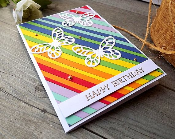 Bright rainbow coloured birthday card with butterflies and