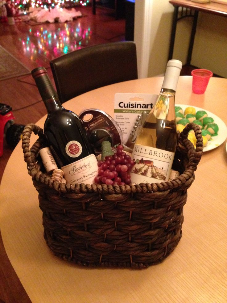 Yankee swap gift idea....all under $35!!  basket, 2 bottles of wine (local wineries), cork screw, and foil cap cutter.  Plastic grapes and old corks under wine.  Brilliant!
