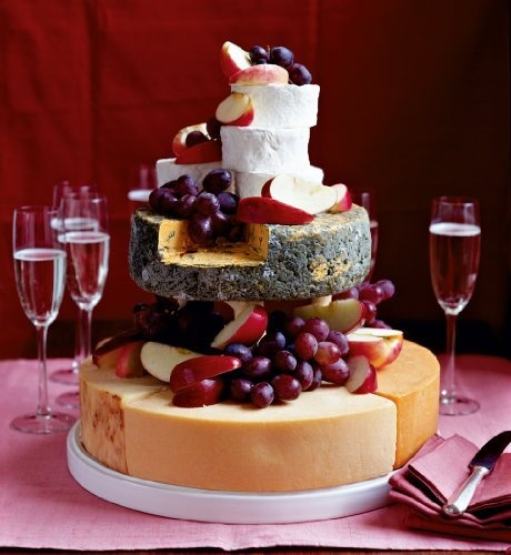 Birthday cake - A celebration cake with a difference - made from five tasty cheeses: Gould's Cheddar; Farmhouse Red Leicester; Farmhouse Double Gloucester; Blacksticks Blue; and Raven's Oak Goat's Cheese - Serving: 100 people  Pack Weight: 9.85kg