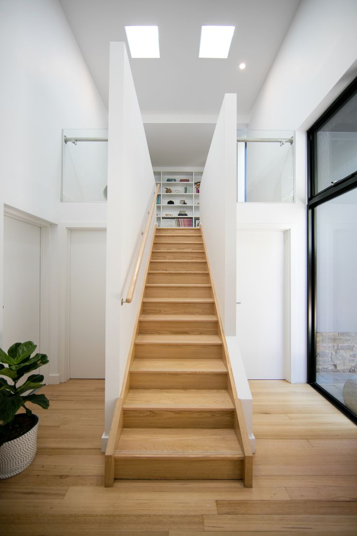 The oak stairs invite visitors to explore the new addition to The Stone House