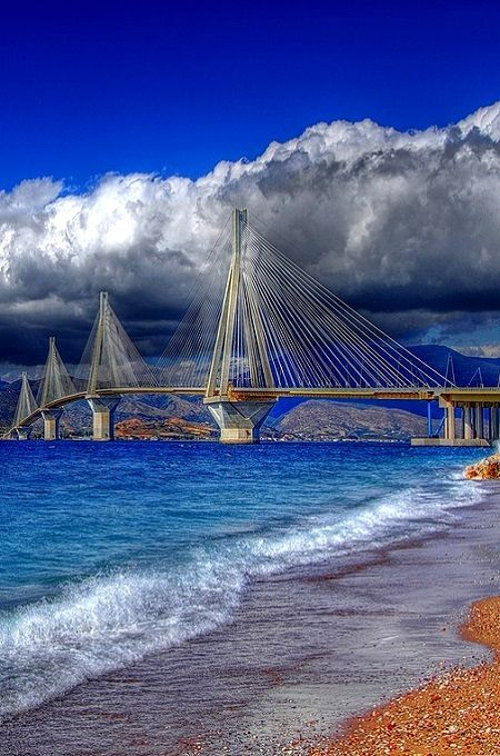 Visit Greece | Low clouds over the Rio- Antirio Bridge - Photo taken from the side of Rio, #Peloponnese, #Greece #visitgreece