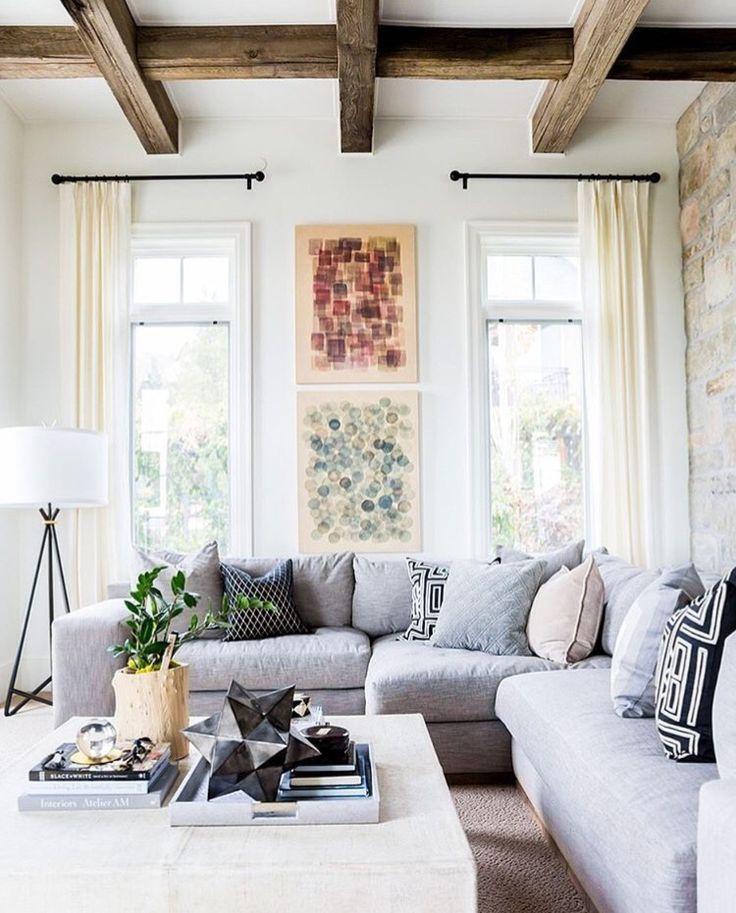 SAVED BY WENDY SIMMONS SAVED TO LIVING ROOM NICE COMFY SOFA LOTS OF PILLOWS  (LOVE THEM ) AND THE CEILING THOSE BEAMS LOVE THE  DECOR. ...