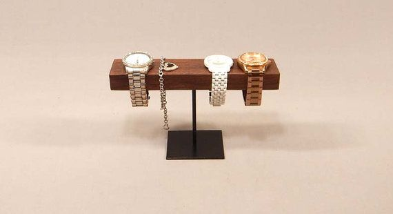 Watch Display  This watch display is a perfect way to show of your special watches. It has room to hold 4 watches comfortably and can even