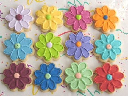 We need to have some sort of food at Prom. What if we bought store bought sugar cookie mix and made like a hundred cookies in the shape of flowers and had people frost them and stuff. The decorating on these flowers are not hard. I could teach a team of 5 how to make it look like this and we'd have it done in like 10-15 minutes