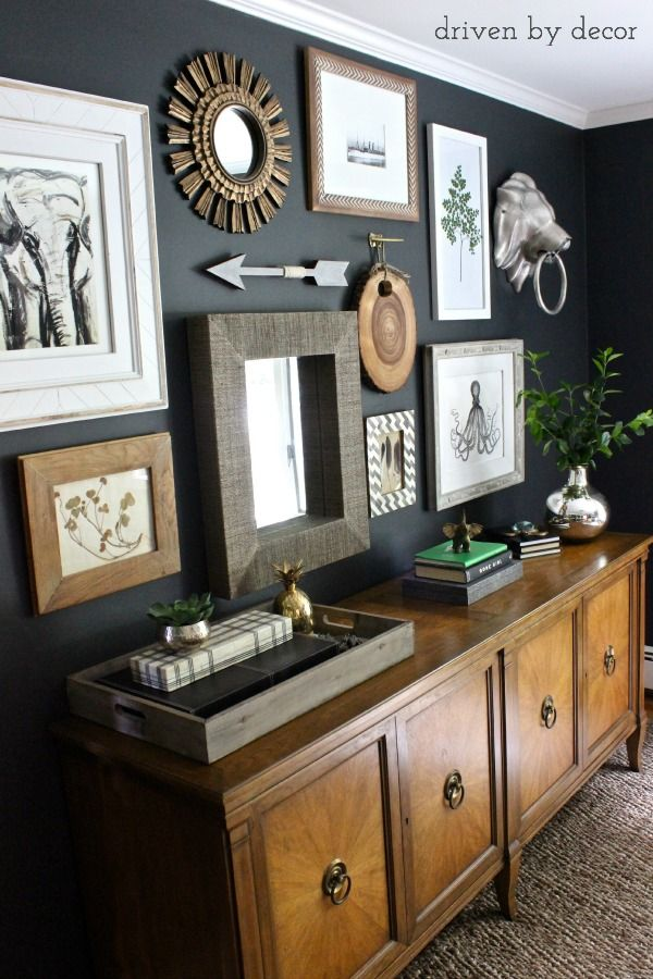 Eclectic collection of art on dark charcoal wall