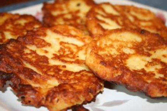Mashed Potato Pancakes Southern Style Recipe _ I added a modern twist to my mom's old Southern recipe. Increase or decrease onion, garlic, hot sauce, & S&P as to your preference. Crispy on the outside, soft on the inside. Bet you can't eat just one!
