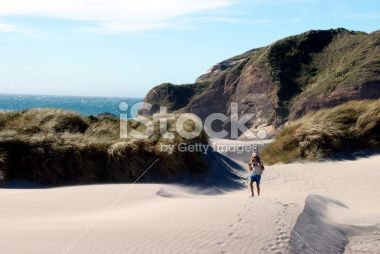 Man with Child on Shoulders, Wharariki Beach, NZ Royalty Free Stock Photo