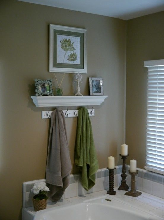 Not a fan of these colors for a bathroom, but love this idea of a shelf over our tub!