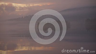 Fog shrouding a Nordic island at sunrise in the summer