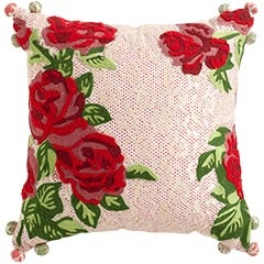 I've seen this at Pier One and it's so pretty. The lace overlay barely conceals a red patterned fabric underneath. The flowers are felt overlay I think. Love it!