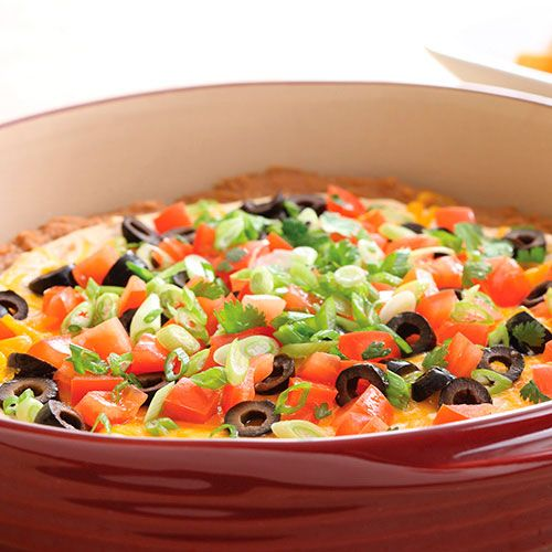 Touchdown Taco Dip - I alter this..  1 can refried beans,  one block of cream cheese (soften and mix with 1 taco mix packet), 1 large chopped tomato, 1 large can black chopped olives, 1/2 cups chopped green onions & 2 cups Mexican blended cheese.  Bake at 350 for 20 minutes and serve with chips!