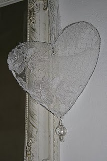 Use bright cheerful/burlap material with pearl; Can't go wrong with hearts and lace together