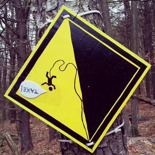 Funny rock climbing lead fall sign.