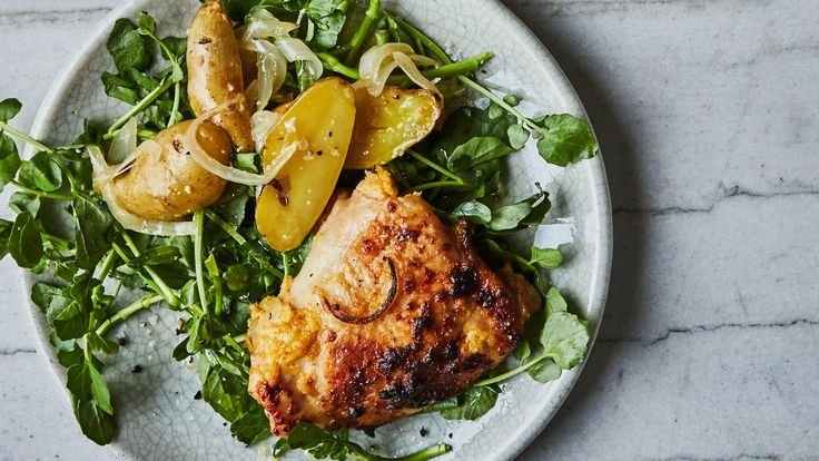 Lime Pickle–Roasted Chicken With Potatoes And Watercress The secret ingredient in this recipe for succulent chicken thighs? Humble mayonnaise, which encourages browning.