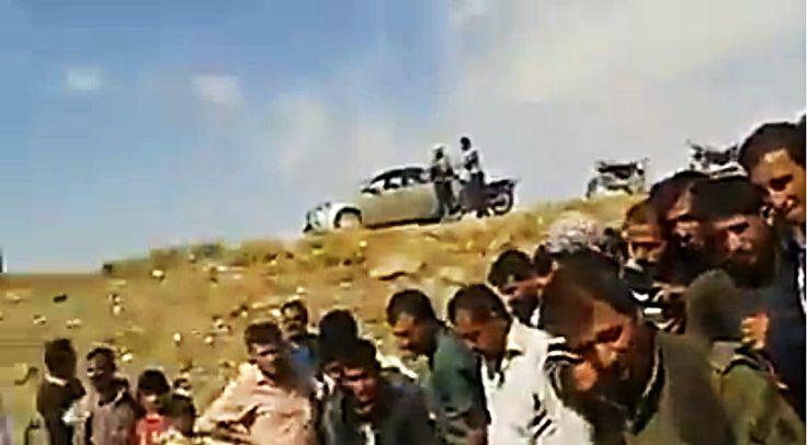 """[Watch] Celebrating Kurds Throw ISIS Fighters Into Mass Grave, Pelt Them With Rocks. Classic example of, """" What Goes Around, Comes Around."""""""