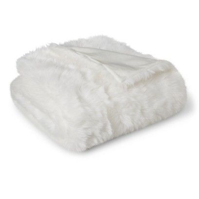 I want to get this to use as a backdrop for babies in the future.  Threshold™ White Faux Fur Throw Blanket