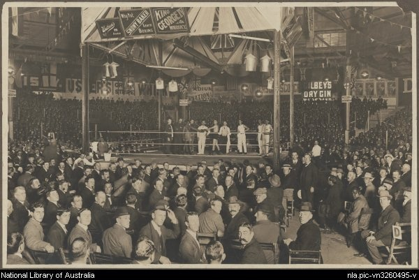 Dave Smith vs Jerry Jerome, Sydney Stadium 19th April,1913. (Part of Arnold Thomas Boxing Collection).The venue for the Sydney concerts in 1965 was the old Sydney Stadium at Rushcutters Bay, just down the road from Sydney's notorious King's Cross. In 1911 a corrugated iron roof was added and the stadium became the site of many more world championship boxing and wrestling matches.