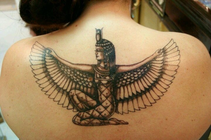 Take a look at this ancient Egyptian deity -- Maat tat done on a girl's back. As a symbol it represents truth, justice, morality and balance.