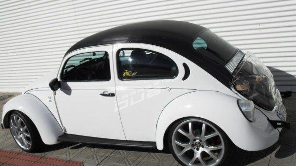 Carro: Fusca Cor: Branco Marca da Roda: Replica Modelo da Roda: Porsche Aro: 19 Modelo Pneu:  215/35/R19 Método de Rebaixamento: Suspensão Fixa Dem
