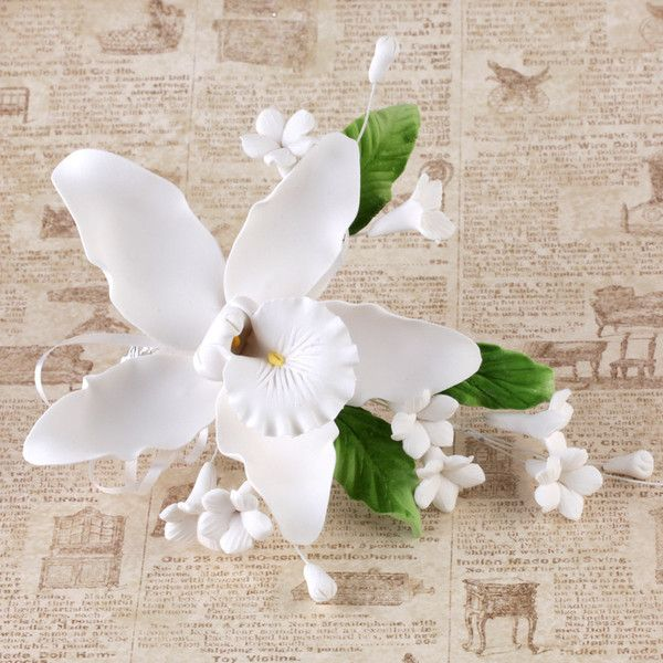 Readymade White Gumpaste Sugarflower Cymbidium Orchid Spray Cake topper sugar flower spray perfect for cake decorating fondant wedding cakes and fondant custom cakes.  No need to make them yourself anymore, simply purchase and take out of the box and decorate your cake.    Caljavaonline.com #caljava #sugarflower