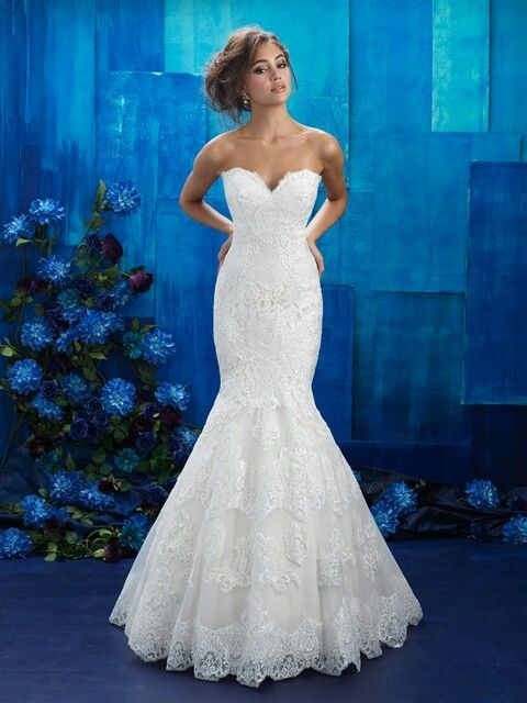 Lovely Crosshatched panels symmetrical appliques and eyelash trim are unique additions to a strapless lace gown