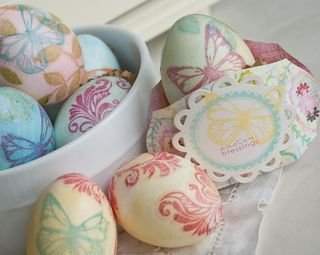Tissue paper & decopage! When you put the decopage glue over the tissue paper, it almost disappears, leaving only the image visible and the eggs almost look as if they are hand-painted.