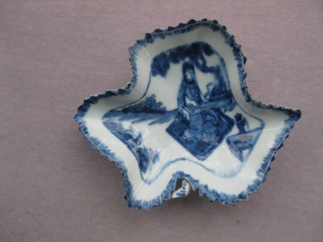 A Bow pickle dish of leaf shape and a serrated edge and painted with a Koto player.  Underglaze blue mark  Circa 1760
