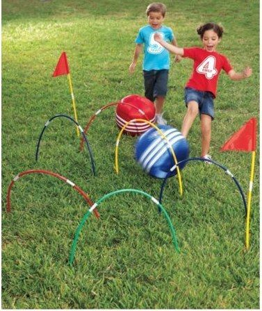 Play a game of kick croquet using hula hoops.