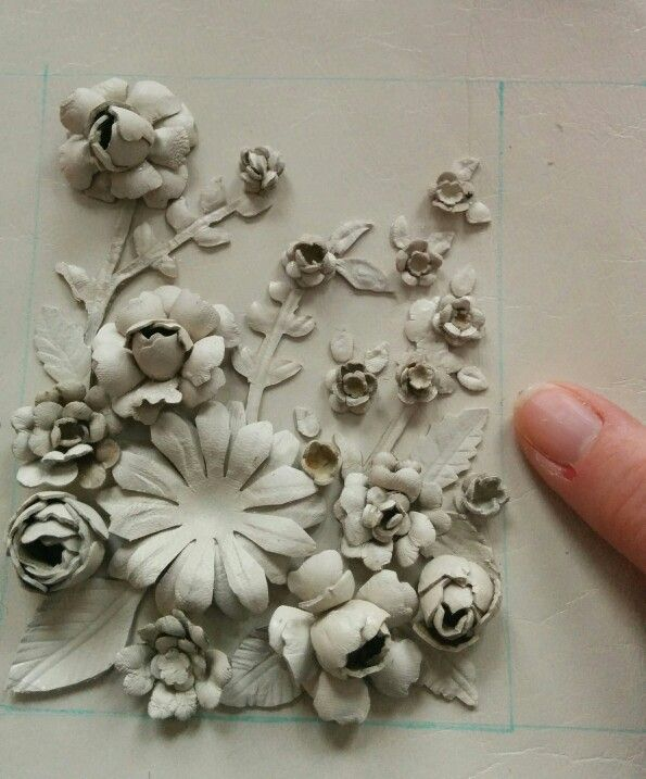 Leather flower art with finger for scale. www.paddyk.ca