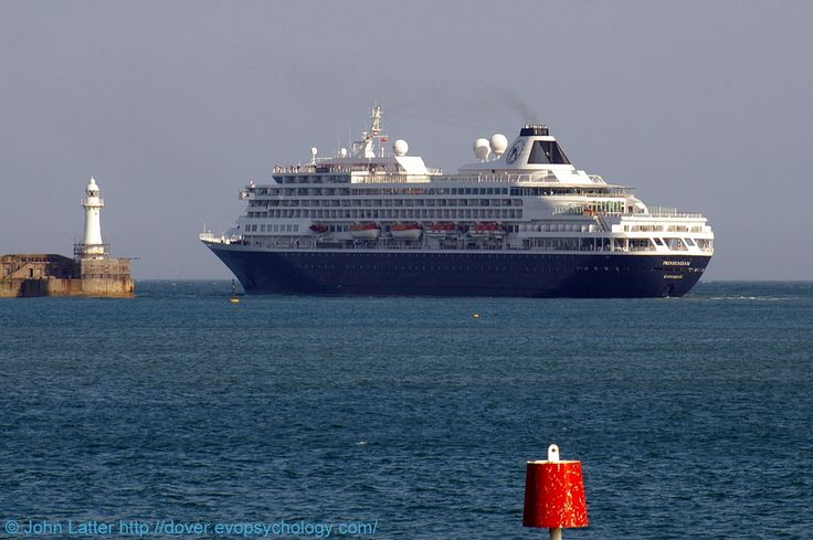 MS Prinsendam Cruise Ship, Western Entrance, Dover Harbour, Kent, England, UK. En route from Fort Lauderdale (USA) via Le Havre (France) to Amsterdam (Netherlands). Ex-Royal Viking Sun, Seabourn Sun. Owner: Holland America Line HAL Cruises. Call Sign PBGH, IMO 8700280, MMSI 244126000, Flag Netherlands. Builder: Wärtsilä in Turku, Finland. Breakwater lighthouse. A 1600-yard zoom photo from the seafront. 2010 Port of Dover, Travel, Tourism and Vacation. See…