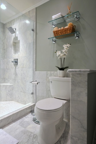 using the same color tile inside and outside shower to visually join the space and make it seem larger.  also, love the fake orchid in white!
