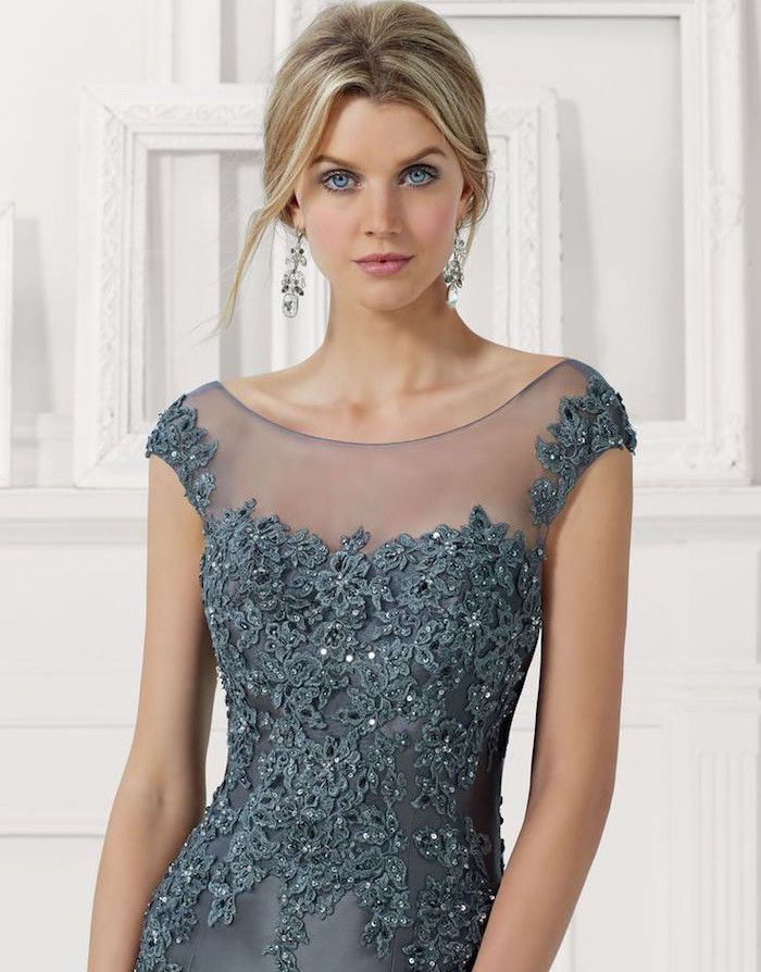 Mori Lee designed a lovely mother of the bride dress for a formal wedding. Love the illusion neckline!
