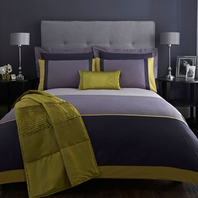 This designer 'Maddox' duvet cover from J by Jasper Conran comes in navy with a luxury sateen face and yellow, grey and dark grey colour block border, perfect for a contemporary bedroom setting.