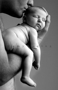 Baby in father's arms