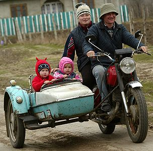 Family from a village in Moldova. One day, I will own a motorcycle with a side car.