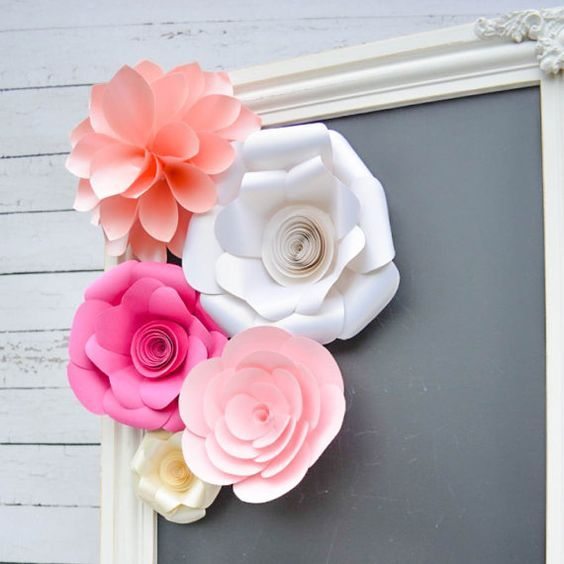 Sweet and feminine these paper flowers make an easy and stylish decoration for your next event This set includes five flowers ready to display, featuring light rose, pink, azalea pink, creamy vanilla, and luxe shimmer white. Our high quality paper flowers are made from thick card stock. Affixed to the back side of each flower is white coated bendable craft wire, allowing you to hang and enjoy your flowers immediately! You will receive five paper flowers detailed below:  (1) Dahlia in…