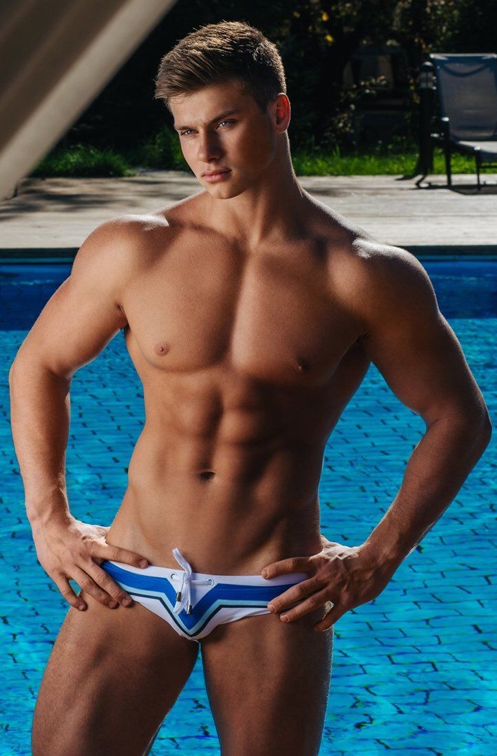 hot guys with abs in speedos having an erection