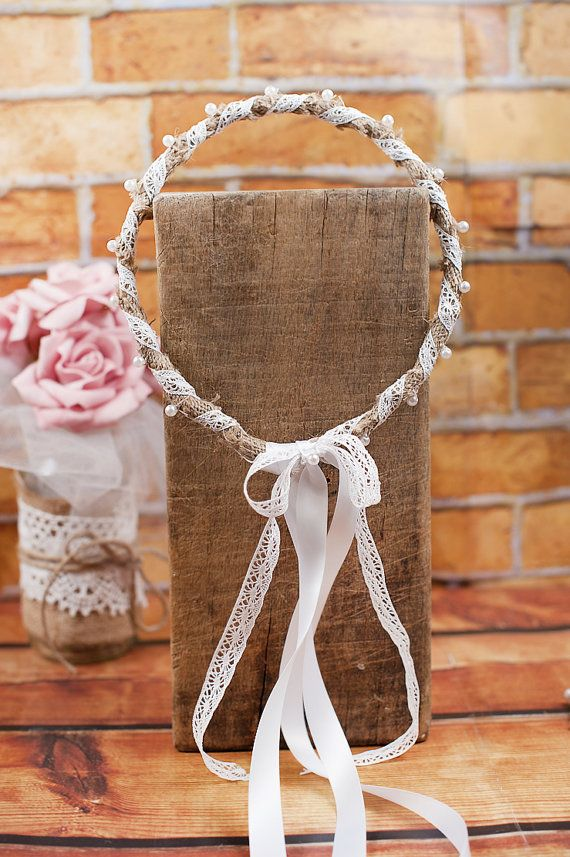Rustic and romantic stefana. Handmade with burlap textile and a white lace all around. In the middle there are white pearls. At the back side there
