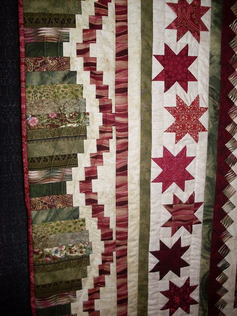 Scalloped log border (looks like it's from Judy Martin's Snake River Log Cabin quilt) and Staggered Star border from her Pieced Borders book. Houston International Quilt Festival 2012 304 by reesiek1