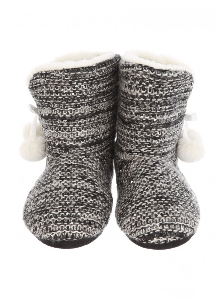 Keep your feet toasty in these comfy grey slippers. In a boot style featruring a super soft lining and pom detailing, they're a must-have for the upcoming co...