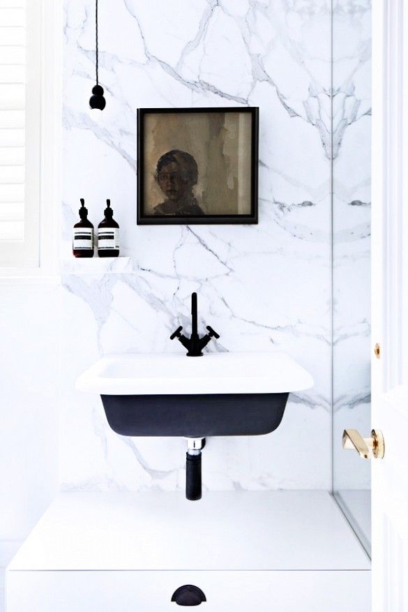 Black and white bathroom with marble walls