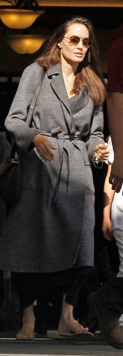 Who made  Angelina Jolie's gray coat, tan flat sandals, and black handbag?