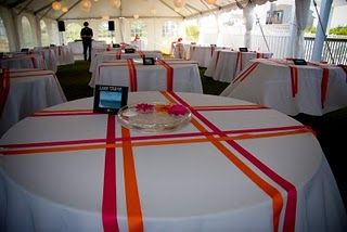 Great idea for table decorations.  Could use school colors for the ribbon