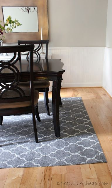 To this tutorial I simply must say: shut up. She used a stencil on a cheap ($18!) plain gray rug and turned it into a glorious geometric patterned area rug.