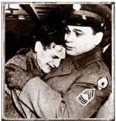 pinner writes: When troops liberated the concentration camps they were unprepared for what they encountered. Here a U.S. soldier holds a victim of Nazi terror sobbing in relief of his liberation.