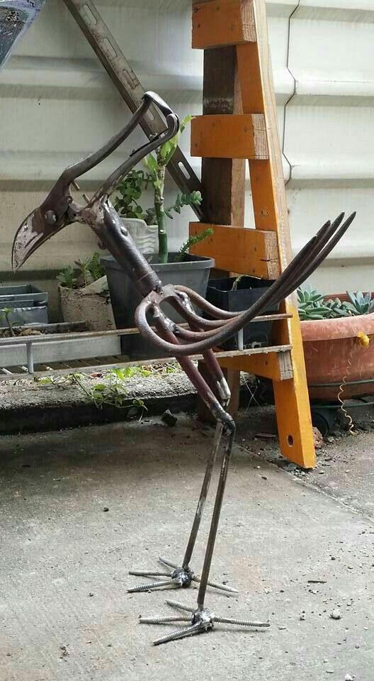 Robot bird sculpture.